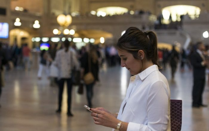 woman looking at her phone at grand central station in new york roy3775 2 5